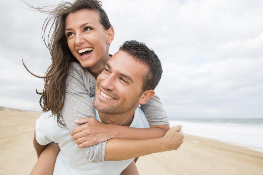 couple smiling | dental crowns and bridges flowery branch ga