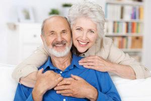 couple smiling with dentures in flowery branch