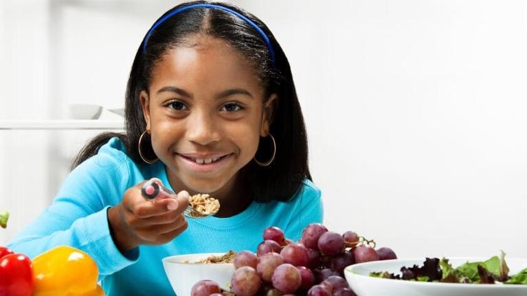 girl eating cereal | family dentistry flowery branch ga