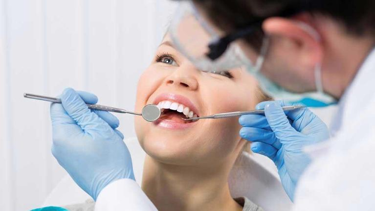 woman getting a dental exam | general dentist flowery branch ga