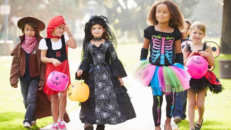 kids walking in halloween costumes | dentist flowery branch ga