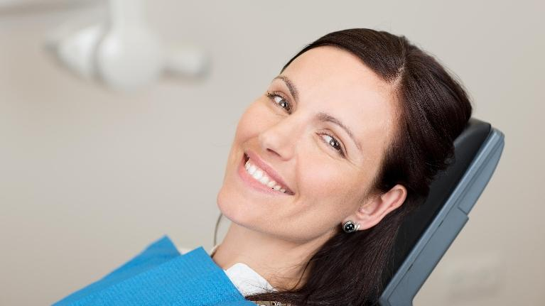 woman in dental chair | tooth extraction flowery branch ga